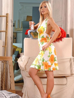 Leggy blonde Tiffany Rousso removes high heels to give footjob and bj