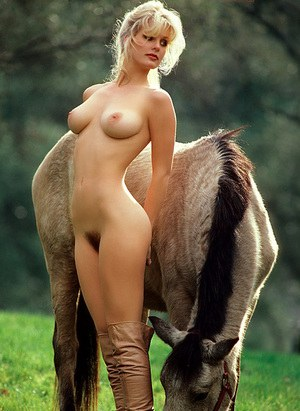 Centerfold Dorothy Stratten posing naked outdoors  showing hairy pussy