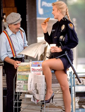 Reality model Barbara Edwards poses in high heels and vintage police uniform