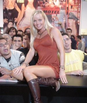 Sexy pornstar MILF Silvia Saint posing fully clothed in jeans and boots