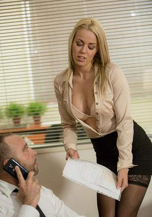 Blonde secretary dripping jizz off of tongue after fucking the boss