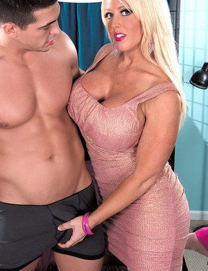 Huge titted MILF Alura Jenson gets her fake big tits sucked wearing stockings