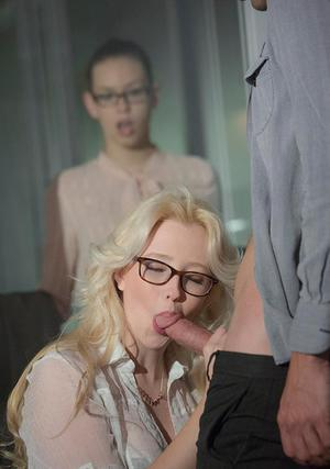 Bespectacled blonde babe Samantha Rone makes a dick cum on her tits