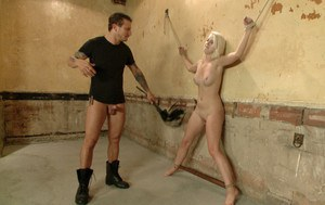 Darcie Belle is chained up, tied up and fucked up in the best way. With Mr Pete as her charming and relentless Dominant.