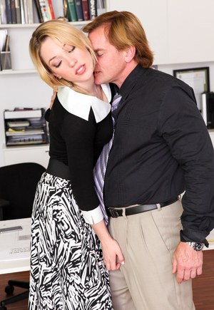 Fully clothed pornstar in heels spreading legs for cumshot in office