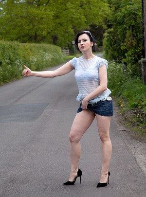 Dark haired amateur Jena flashes panty upskirt spreading legs outdoors