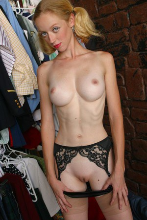 Very skinny girl with pigtails & long legs in fishnet stockings strips