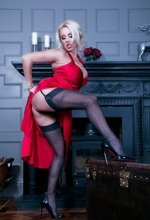 Stunning babe Dannii Harwood is the lady in red! She's come back home horny from a party wearing a gorgeous silky red dress, and can't resist a tease and a play!