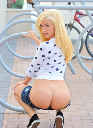 Hot young blonde with perky tits in shorts baring small round ass in public