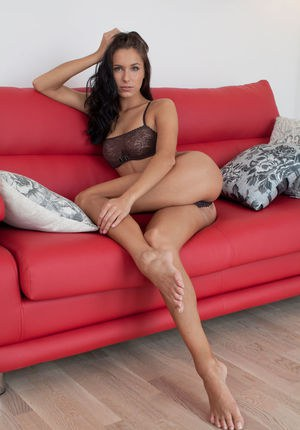 Leggy barefoot brunette Diana G freeing nude girl parts from lingerie