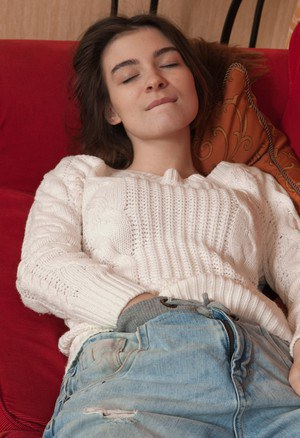 Taffy is laying around on her red couch in her white sweater and denim jeans. She strips naked, feeling horny, and fondles her hairy pussy and body. Her hands start touching her hairy pussy and ass.