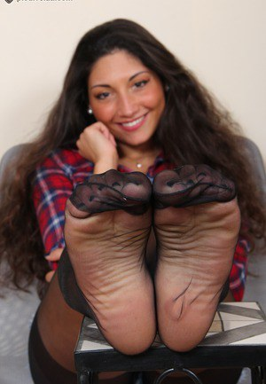 Teen alternative girl playing with her perfect feet