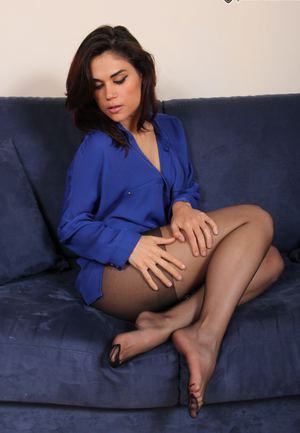 Gorgeous brunette showing her perfect feet