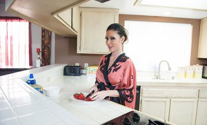 Fake titted brunette Jessica Jaymes giving titjob & sucking balls in kitchen