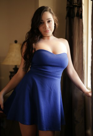 Busty brunette non nude solo girl Karlee Grey posing in sexy tight dress