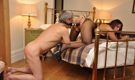 Consort Carly beats her male slave's buttock with crop and makes him swallow her away