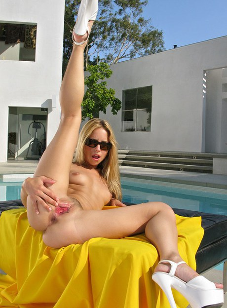 Bleached-blond Lindsey Meadows by pool toying hairless kitty with toy & anal fisting
