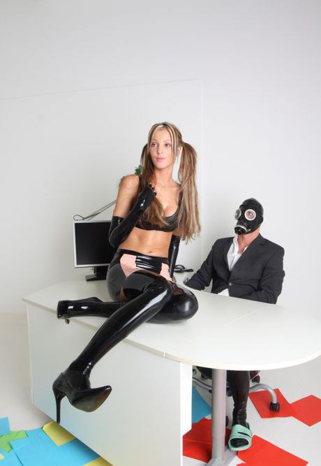 Nifty Lara Love in ponytails & latex gets an office coupling from a boy in a gs mask