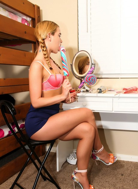 Immature gentlewoman with frisky jugs has a lollypop while sucking ramrod