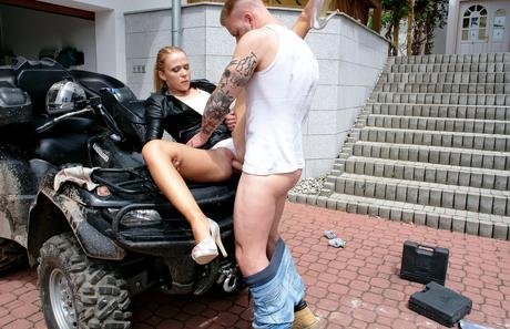 Warm blond in leather microskirt parks her vagina on mechanic's rod in private-road