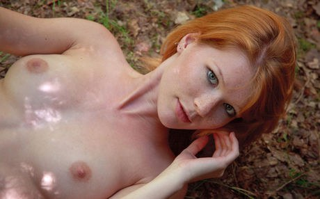Bleakness red-haired Mia Sollis shows her well built body on cut line in forest