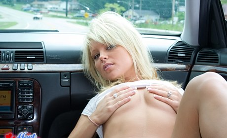 Bleach blonde amatuer Madden flips the birdie while pestering in g-string in her auto