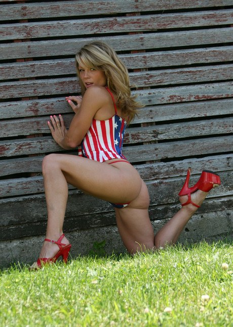 Dilettante frau Gratify Madden poses non naked in Usa themed attire and a thong