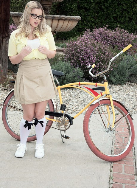 Pretty Codi Vore parks her bicycle to disclose her stout vast jugs outdoors