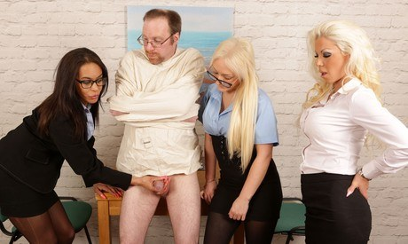 Appareled ladies put bloke in a straightjacket and suctioning his helpless shlong