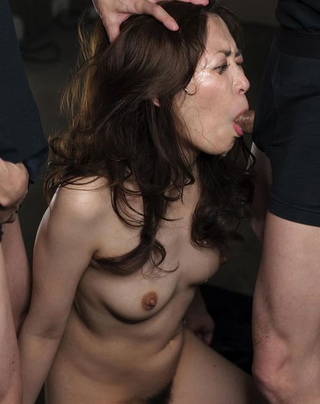 Neat oriental girly with unshaved vagina on her knees to accept hot ejaculate on face