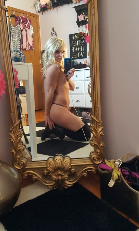 Pleasing bleached-blond inexperienced Enchant Madden collects selfies while eliminating her garb