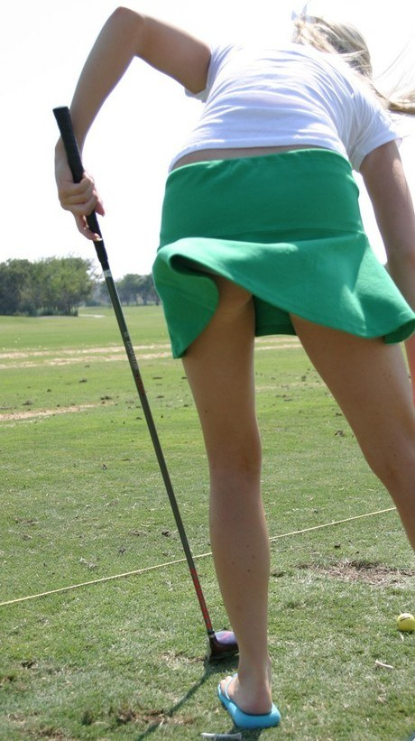 Delightful light-haired mistress Skye Model glows her cotton panties on the golf course