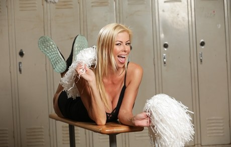 Torrid fair-haired with elephantine oversize hooters spreads with her pom poms in the locker room