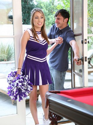Teen girl Allyssa Hall gets fucked on a pool table in her cheerleader outfit