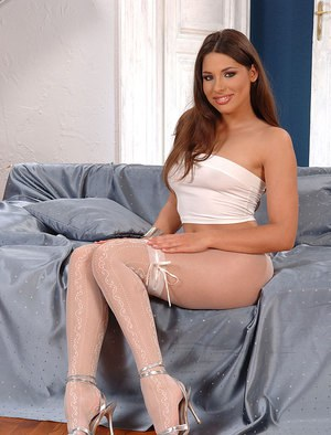 Flexible solo girl Zafira rolling pantyhose down and off long legs and feet