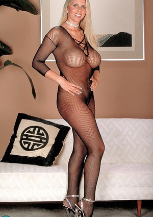Natural blonde masturbates after freeing her big boobs from bodystocking