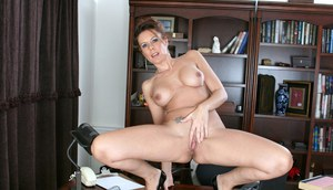 Classy woman Victoria removes her glasses before stripping to masturbate