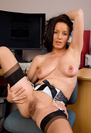 30 plus businesswoman with dark hair exposes her tits and twat in office chair