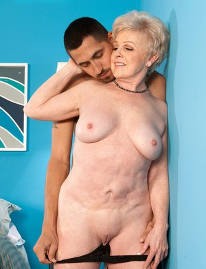 Horny granny Jewel gives her young lover a saggy titjob nd sucks his cock