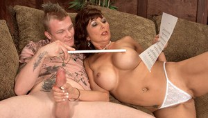 Big titted mature lady Desi Foxx seduces a younger guitar player on sofa