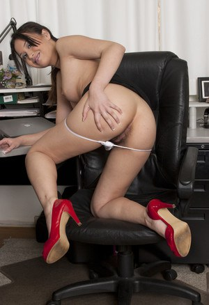 Asian secretary removes her upskirt thong at her desk in red heels
