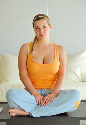 Amateur babe freeing large all natural juggs while doing yoga