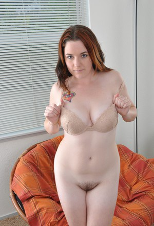 Chubby first time undresses and lays her beaver out for all to see