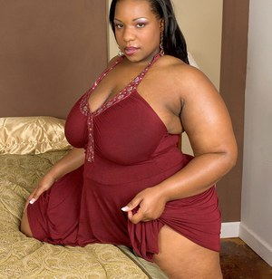 Fat black woman with an even bigger booty undresses to masturbate