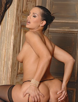 Gorgeous solo model Eve Angel strips to stripes stockings and heels