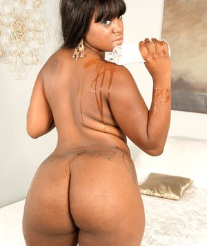 Thick black chick covers her big booty in oil after 2 piece lingerie removal