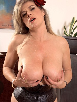 Hot mature pours milk on her huge pierced boobs and spreads her ass naked