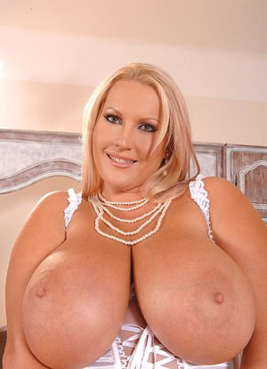Hugely busty MILF Laura M reveals massive big tits & BBW ass in white lingerie