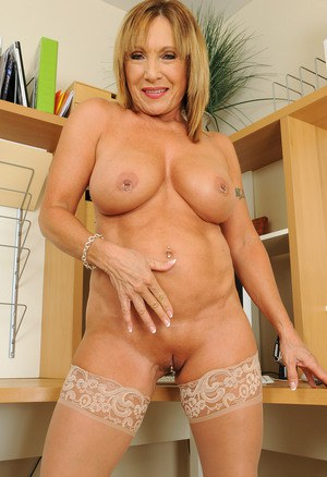 Beautiful mature Luna reveals nice big tits while spreading nude on her desk