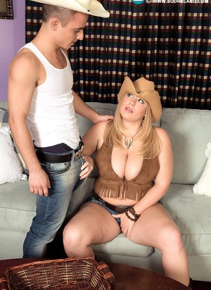 Hot fatty cowgirl takes out her massive big tits to give skinny dude a titjob